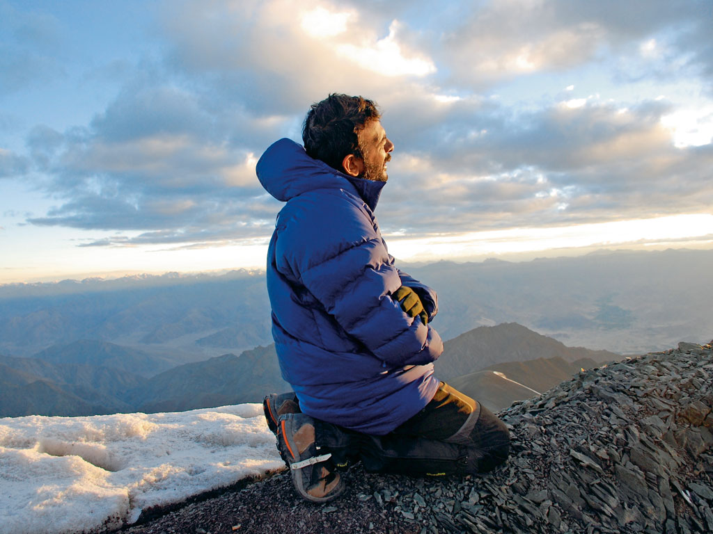 T.M. Krishna singing atop a mountain
