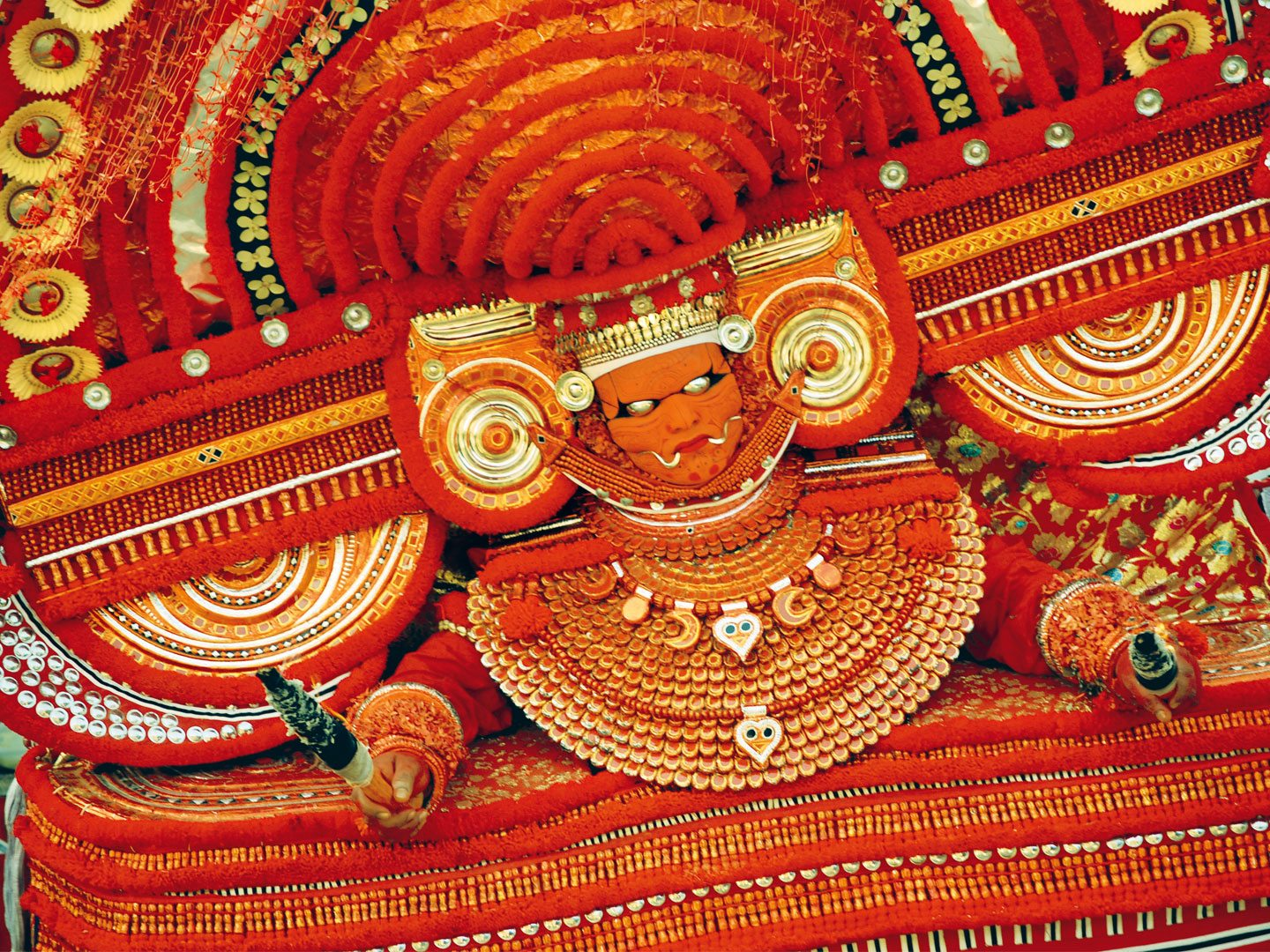 Muchilottu Bhagvathy is said to be so fierce that her eyes unleash fire. The Theyyam performer wears eye masks of silver with the tiniest pinhole to see through. Photo: Aliyeh Rizvi