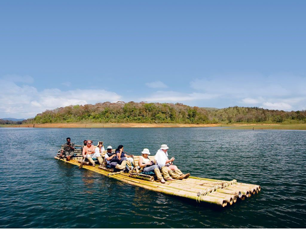 Visitors can choose to drift away from the sounds of civilisation with a slow bamboo raft ride on Periyar Lake. Photo: Robert Harding/Indiapicture