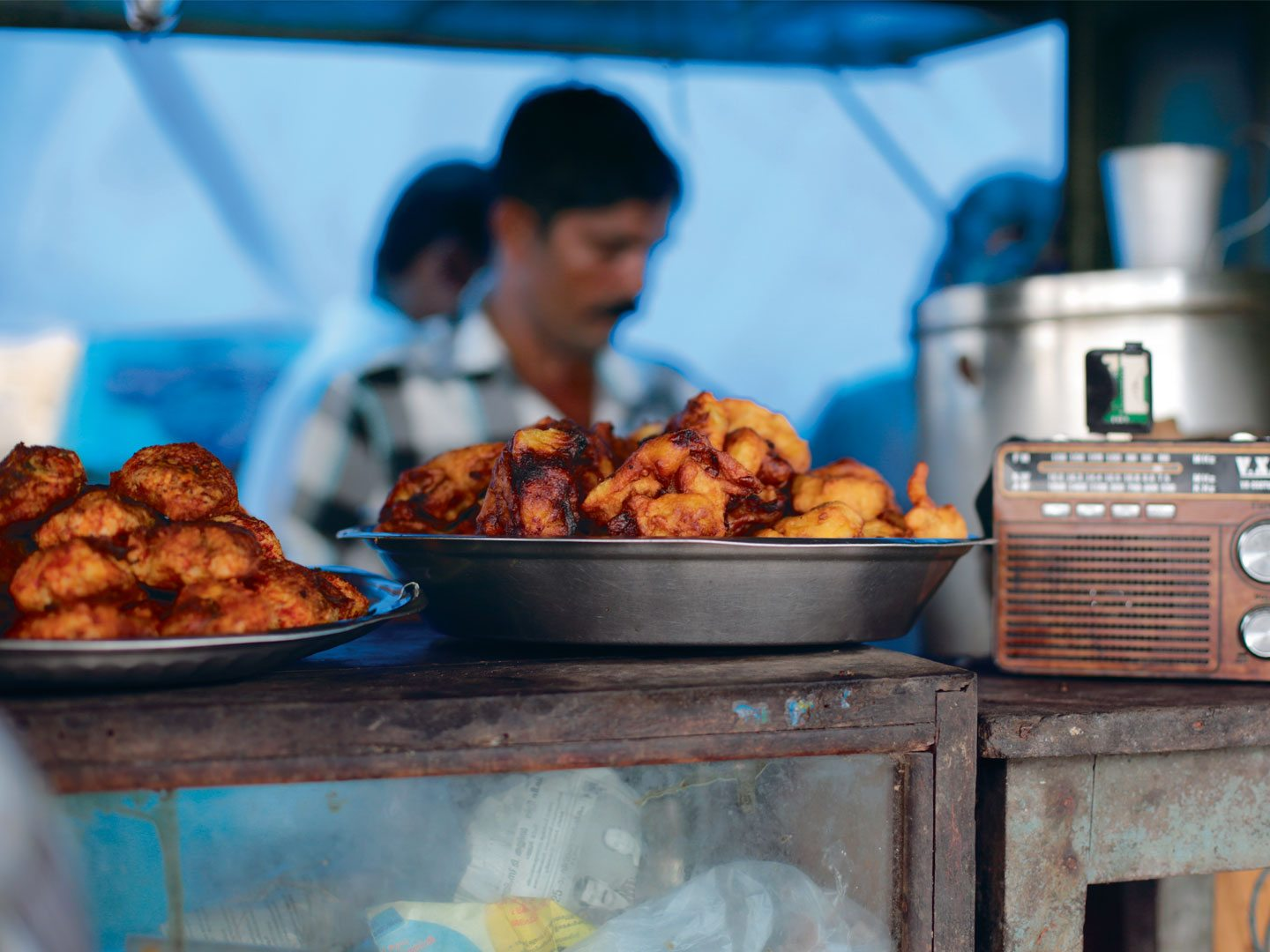 Thalassery's roadside stalls serve yummy snacks such as ari-kadukka (stuffed mussels) or spicy fried slices of tapioca. Photo: Aysha Tanya