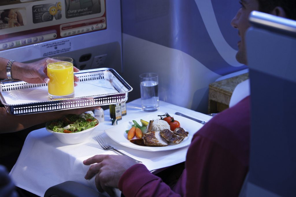 Dining onboard business class. Photo courtesy Emirates Airline