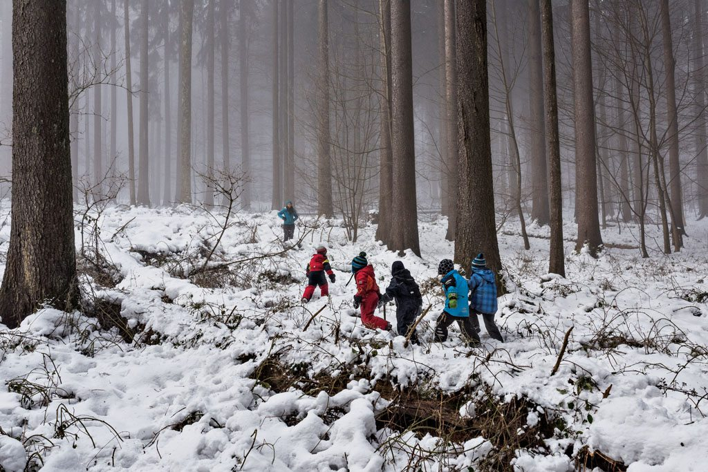 "In a ""forest kindergarten"" in Langnau am Albis, a suburb of Zurich, Switzerland, children spend most of the school day in the woods, regardless of the weather. They learn whittling, fire starting, and denbuilding; they're able to explore. Supporters say such schools foster self-confidence and an independent spirit."