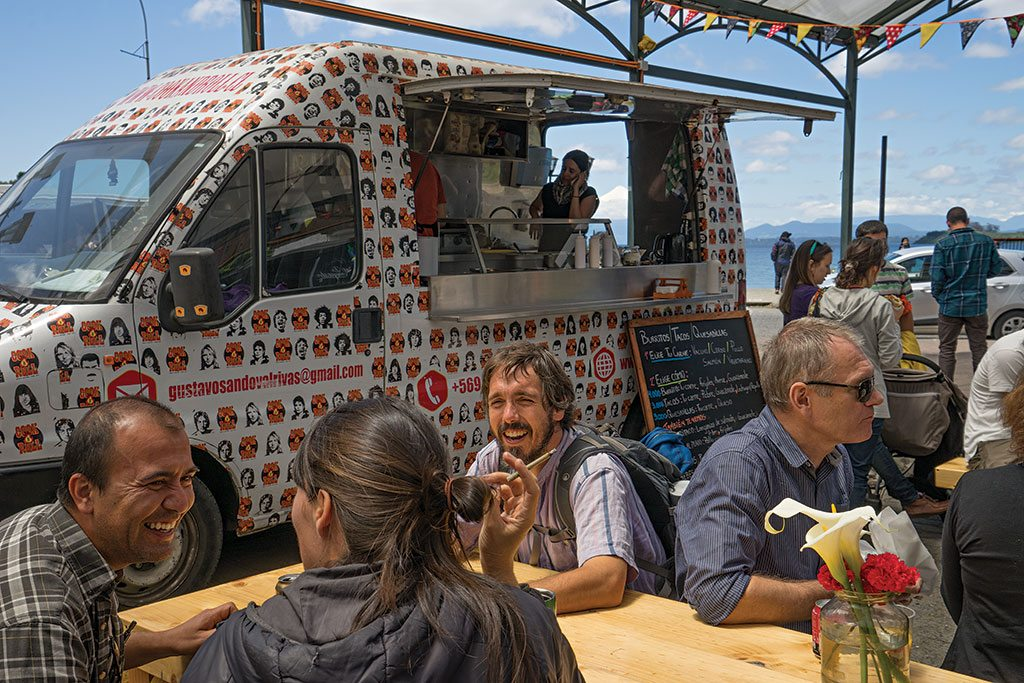 A food truck wrapped in head shots of rock stars dishes up tacos and other specialties of chef Gustavo Sandoval Rivas along Lake Llanquihue. Photo: Pablo Corral Vega