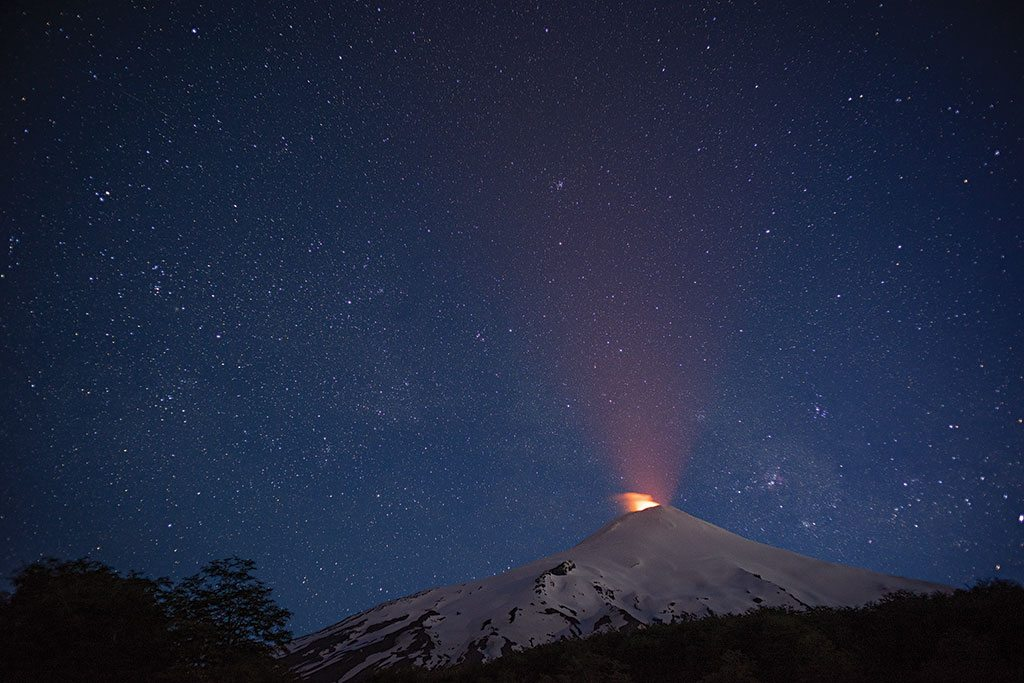 One of South America's most active volcanoes, Villarrica lights up a star-splashed night sky. Its most recent eruption was in July 2015. Photo: Pablo Corral Vega