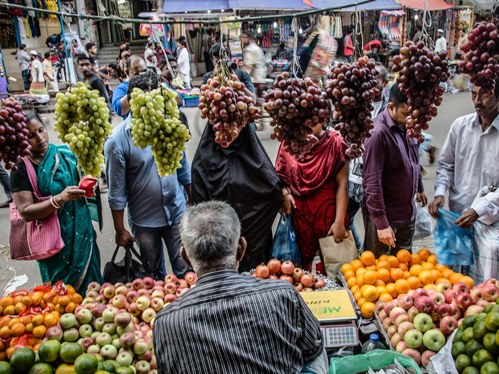 It appears that everybody's got grapes on their mind at this fruit vendor's stall in Old Dhaka.
