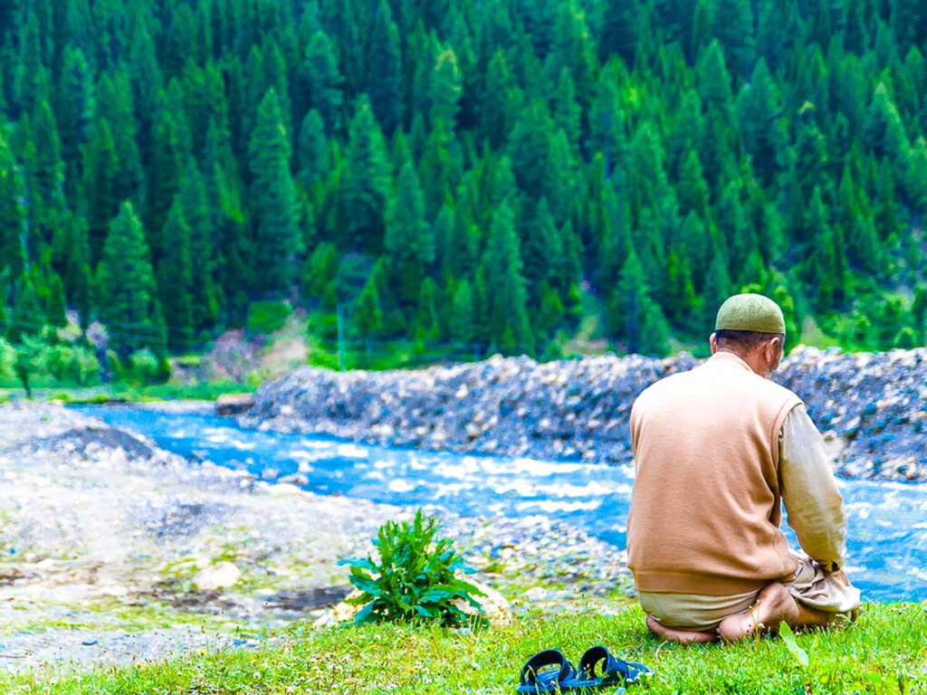 Gulab Khan, a guide in Jammu & Kashmir's Gurez Valley, takes a break in between his tours to pray during the month of Ramadan.
