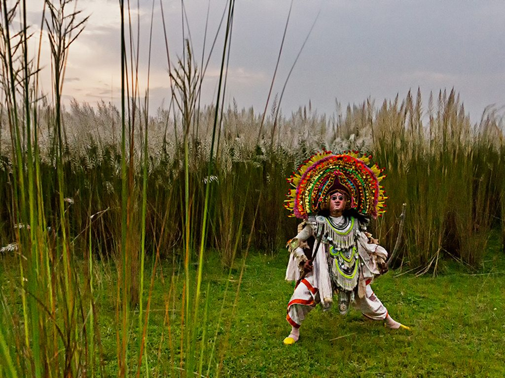 Purulia's chhau dance form has its roots in tribal warrior dances. Performers, wearing masks that resemble fierce dieties, stomp their feet and perform backflips during a show.