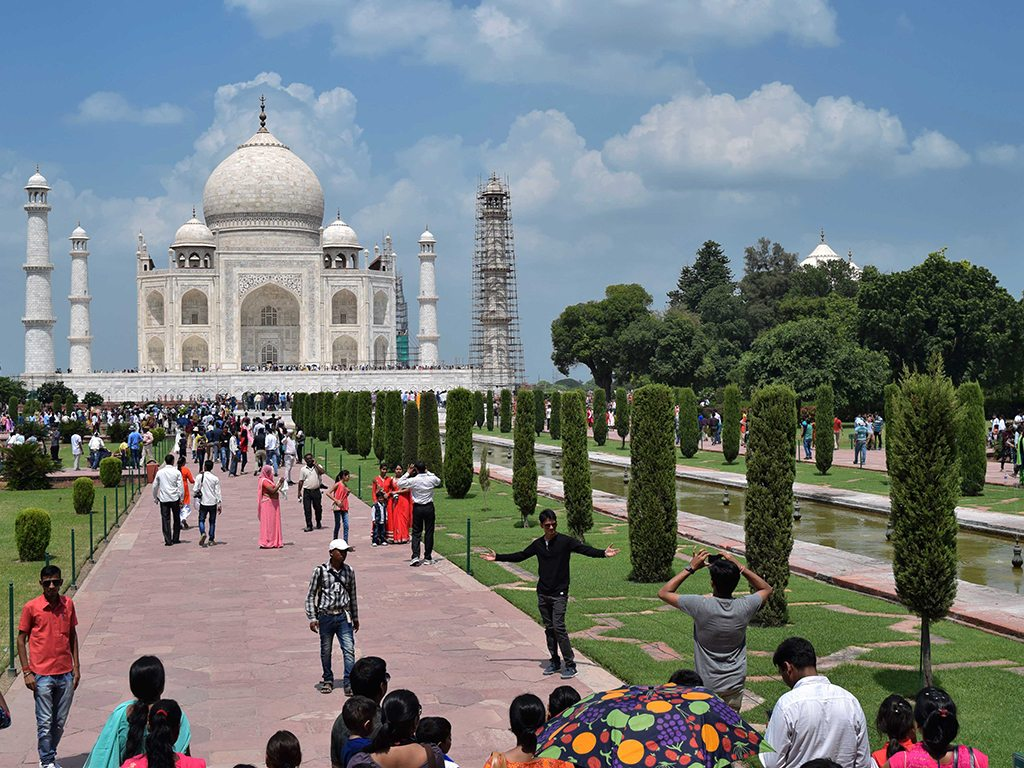 The Taj Mahal attracts travellers from all over India and the world, including Bollywood fans who strike their favourite heroes' trademark poses.