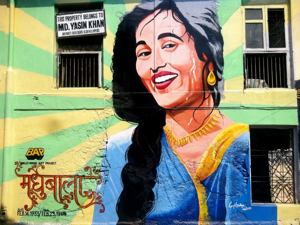 Bright murals across the city show some of tinsel town's biggest stars in their most iconic poses, like this one of Amitabh Bachchan in Deewar. Created in the classic style of hand-painted movie posters, these murals by Ranjit Dahiya's Bollywood Art Project celebrate the centennial of Indian cinema. Photo courtesy Bollywood Art Project