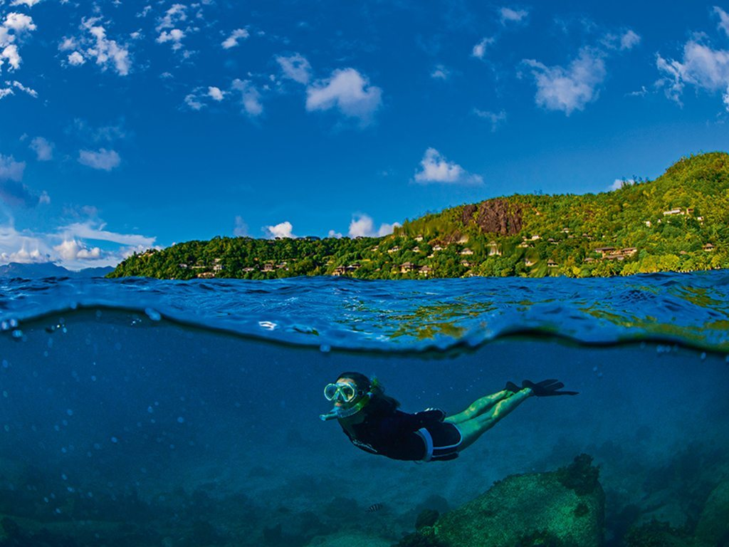 The waters of Petite Anse beach in Mahé, Sychelles, have thriving coral gardens, perfect for snorkeling. Photo: Dhritiman Mukherjee