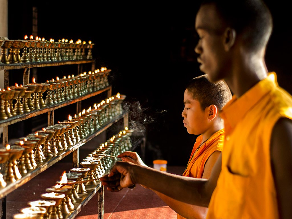 Buddhists trainee monks light butter lamps at the Namdroling Monastery in Bylakuppe, Karnataka, a ritual that is meant to refresh the mind and give pause in the day.