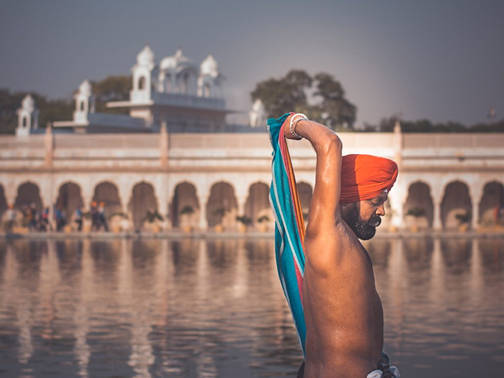 A devotee takes a dip in the sarovar at New Delhi's Gurudwara Bangla Sahib, cleansing himself in the sacred waters before offering respect at the shrine.