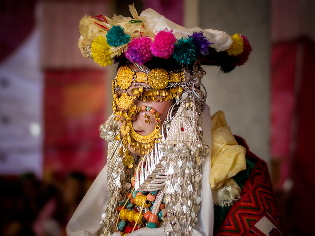 A bride in Kinnaur, Himachal Pradesh, waits patiently before her marriage ceremonies.