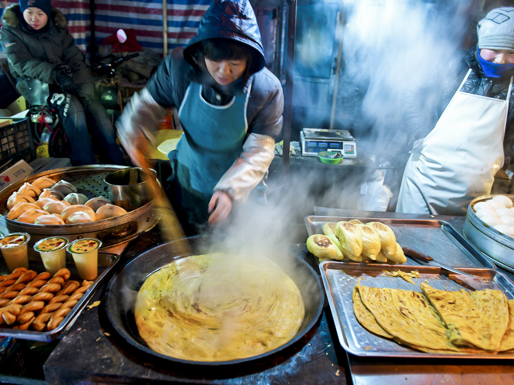 Hawkers in Beijing peddle everything from donkey burgers to barbecued chicken wings and jianbing, a Chinese pancake that's made on a cast-iron griddle. Photo: iStock.com/Tarzan9280