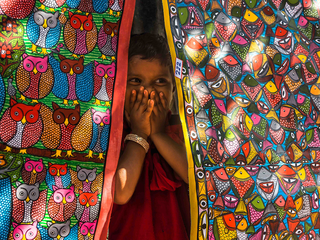 The artist village of Naya, in West Bengal, is a famous hub of pata chitra, the traditional art form of depicting tales from mythology and folklore on scrolls.The colourful works can be found all over the village, transforming it into a vibrant playground, as this child discovered.