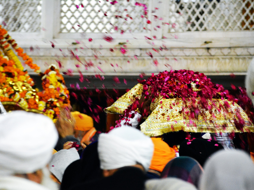 Each day before dawn, the Guru Granth Sahib is transported on a palanquin to the sanctum sanctorum of Amritsar's Golden Temple, to be read from until late into the night.