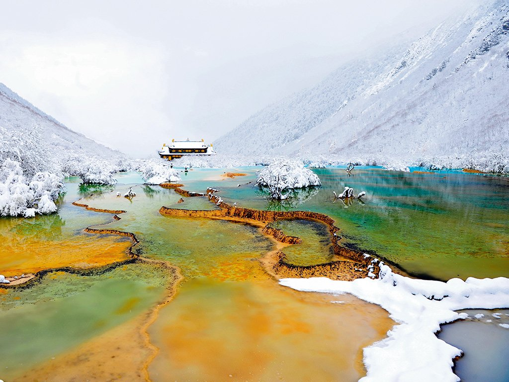 The Yellow Dragon Valley in the Sichuan Province of China is named for its collection of ponds and lakes, which shimmer in shades of bright blue, green and yellow under sunlight. Photo: Nawapa/Getty Images