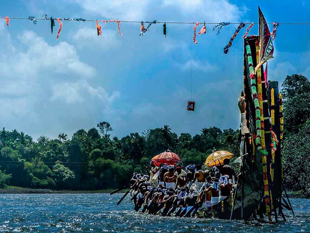 "Aranmula Vallamkali is a boat race held on River Pamba in the idyllic village of Aranmula, Kerala. The snakelike boats, called ""palliyodam"", are a towering presence, with the rear portion extending to about 20ft high."