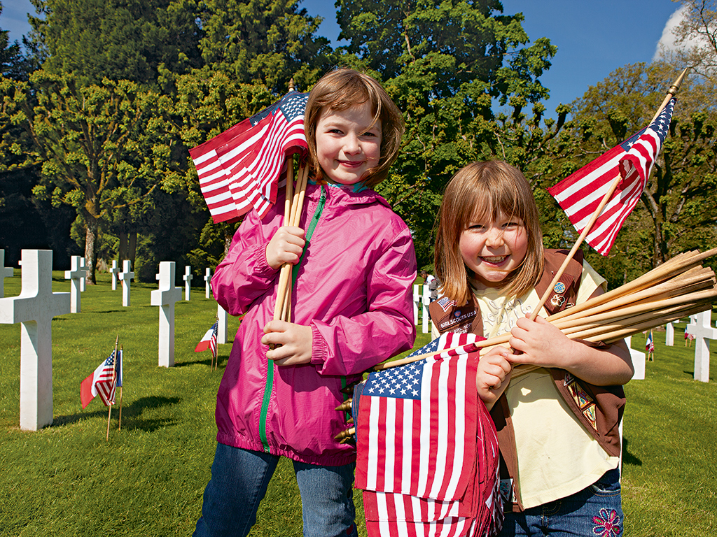 Girl Scouts living in Germany plant flags at the Meuse-Argonne American Cemetery. Photo: Kris Davidson
