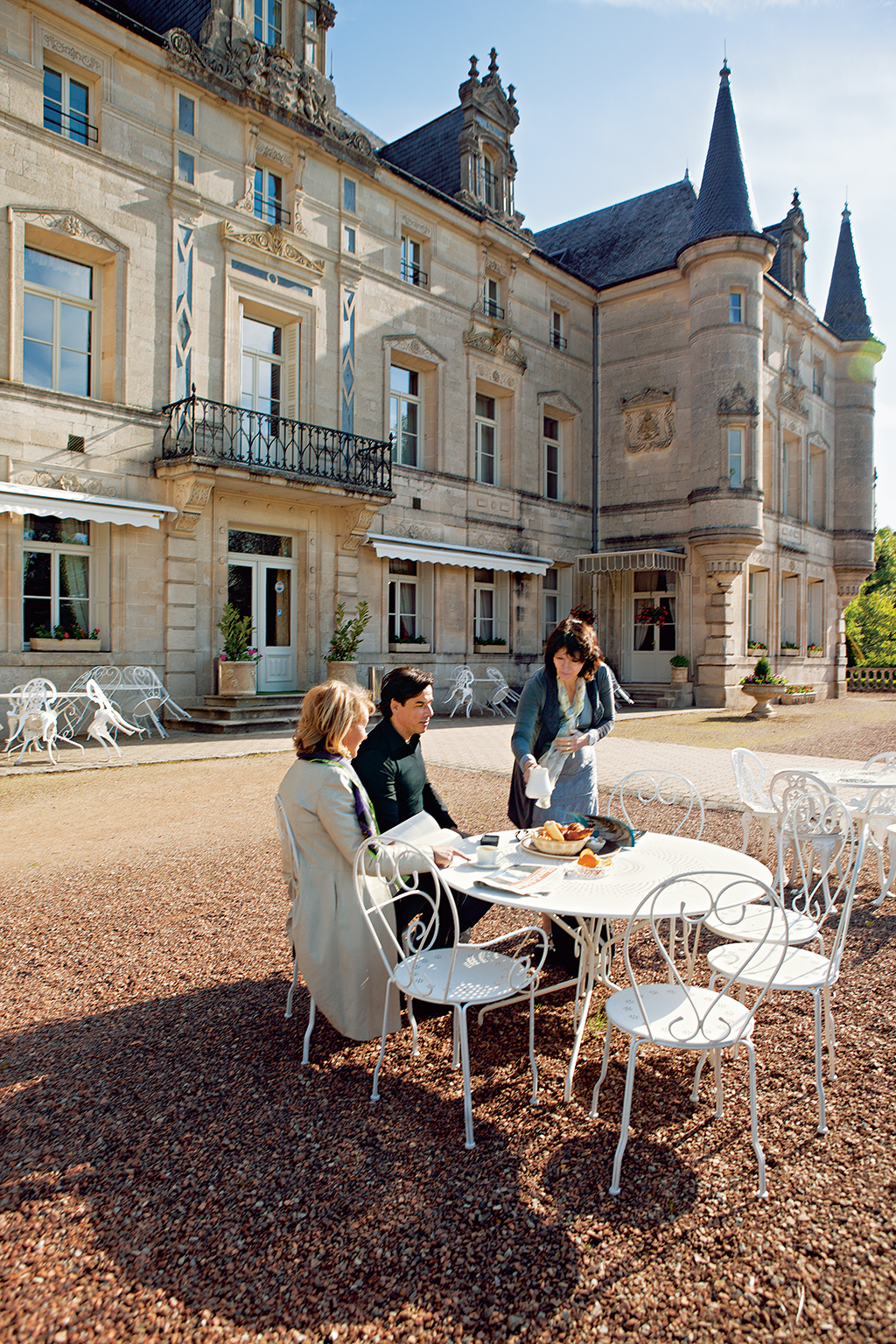 A couple enjoy breakfast al fresco at Château des Monthairons. Now a hotel, the mansion served as a WWI hospital. Photo: Kris Davidson