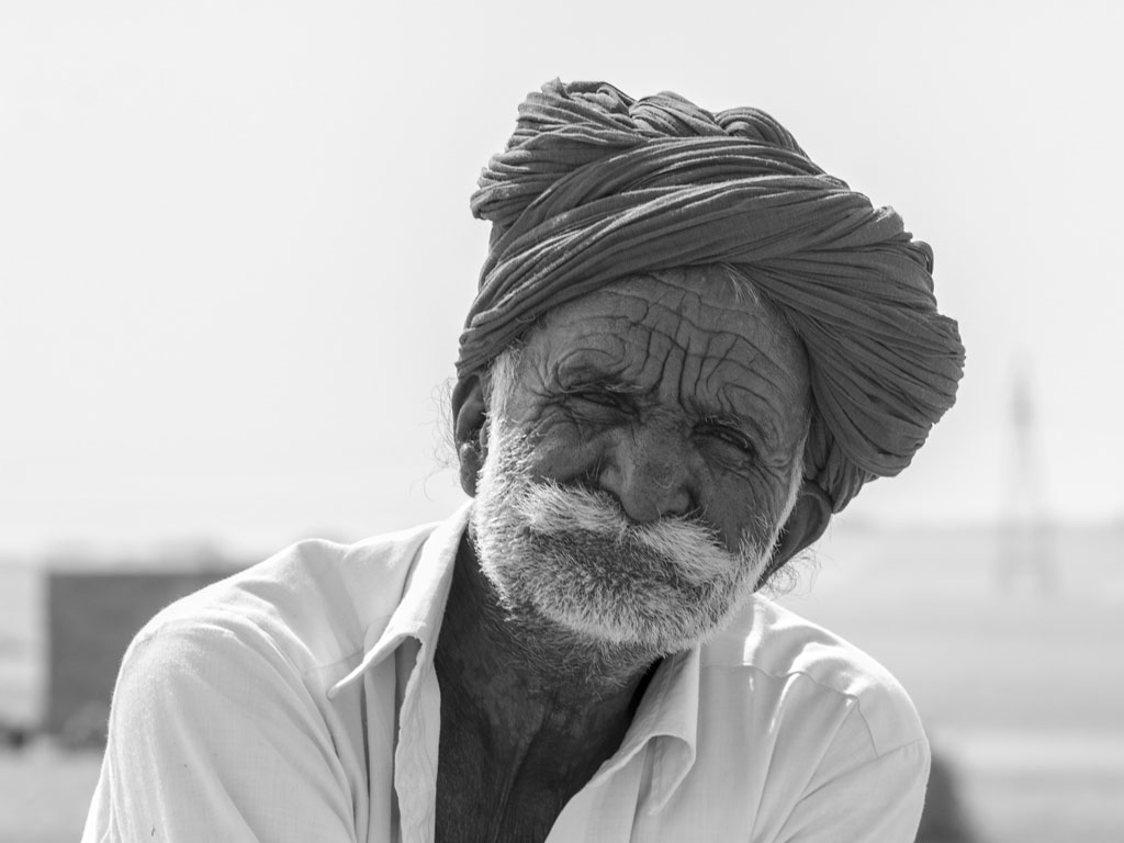 There are some portraits which haunt you. This one, of a man with a wizened face,  will definitely linger in our memories. It is clicked in Thar Desert, Rajasthan.