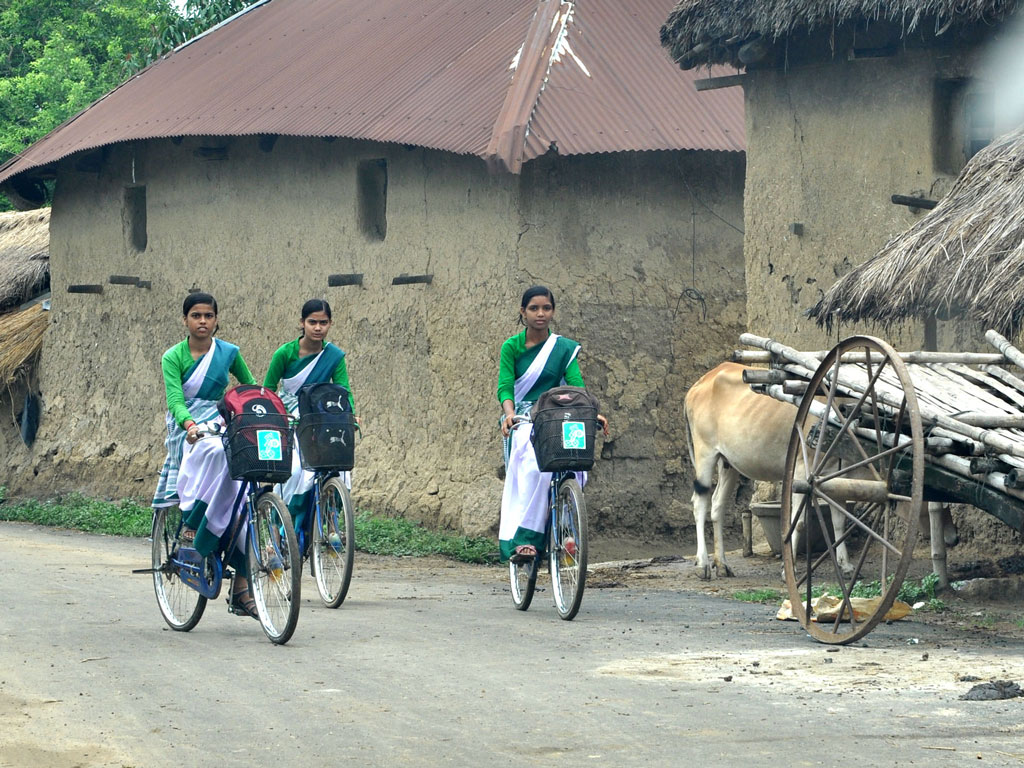 Education for the girl child should not stop at an early age: these young women are on their way to school in West Bengal.