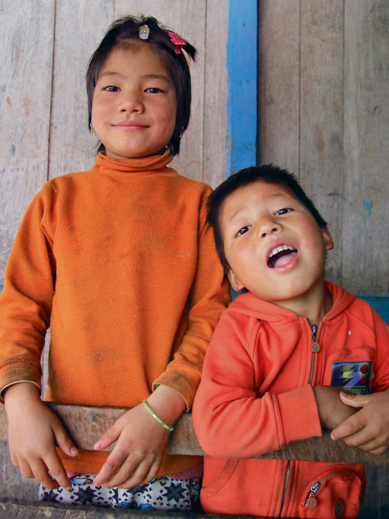 Curious children in Khampa, at a house where the author stayed.