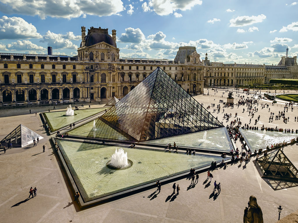 The Louvre, in Paris, has been a fortress, a royal palace, and now reigns as one of the world's busiest museums. Photo Courtesy: Chris Sorensen/Gallery Stock