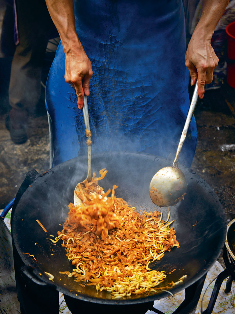 Char kway teow and popiah are favourites at Lebuh Keng Kwee's hawker centre. Photo By: CarlinaTeteris/Moment/Getty Images