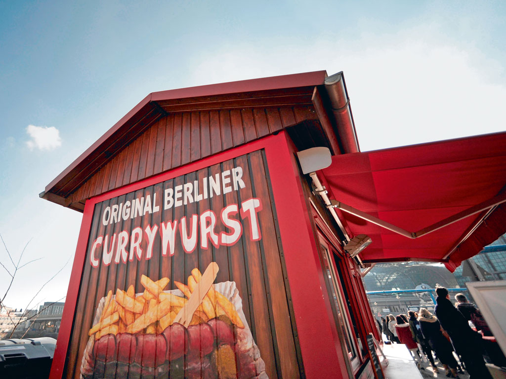 The storied, modest snack of currywurst is ubiquitous in Berlin. Photo by: Peter Cripps/Alamy/indiapicture