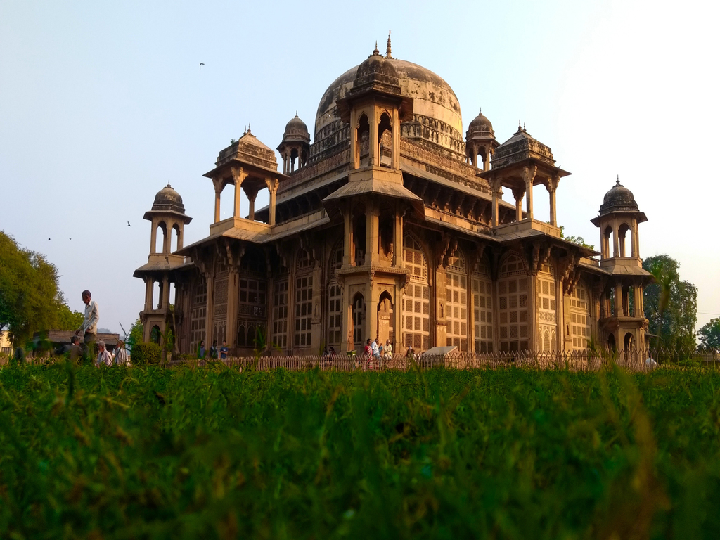 One of Akbar's nine jewels, Tansen has a prominent role in Hindustani classical musical.  His tomb is built in the style typical of Mughal architecture, and is located in Gwalior.