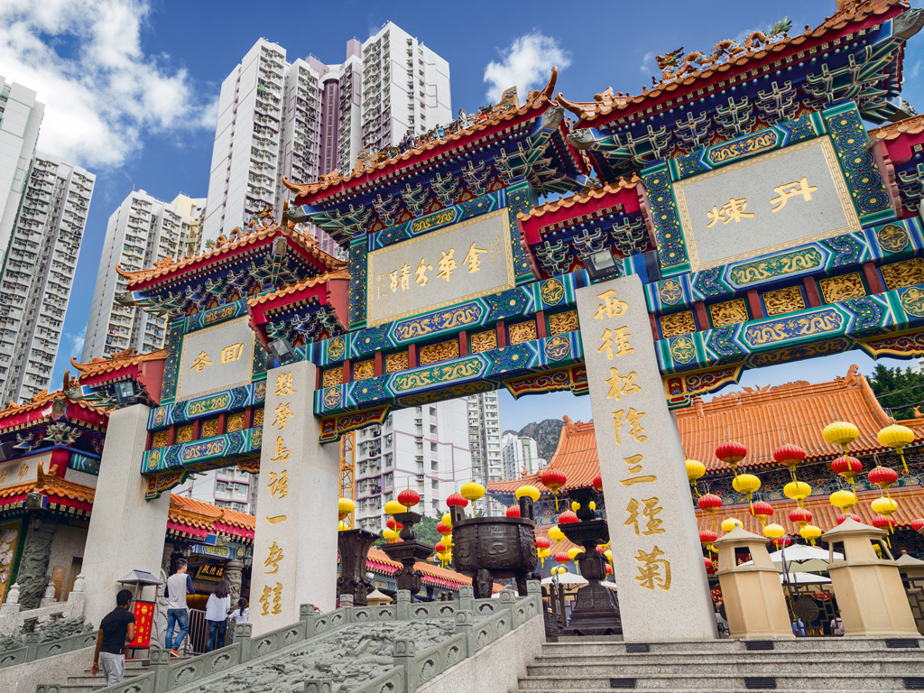 Skyscrapers tower over the Sik Sik Yuen Wong Tai Sin Temple, a major tourist attraction in Kowloon. Photo by: Tuomas Lehtinen/Moment/Getty Images