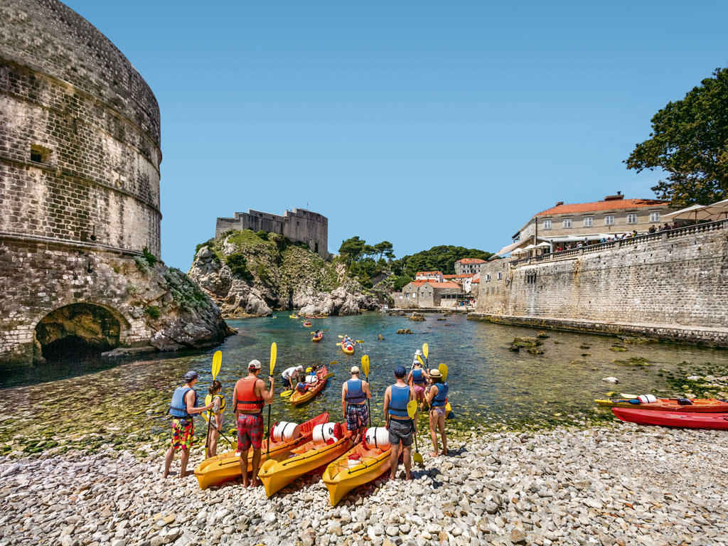 From Dubrovnik, visitors can set sail on a kayak or canoe along the Adriatic Sea to visit nearby spots like the Lokrum and Elafiti Islands. Photo by: Sabine Lubenow/AWL images/Getty Images