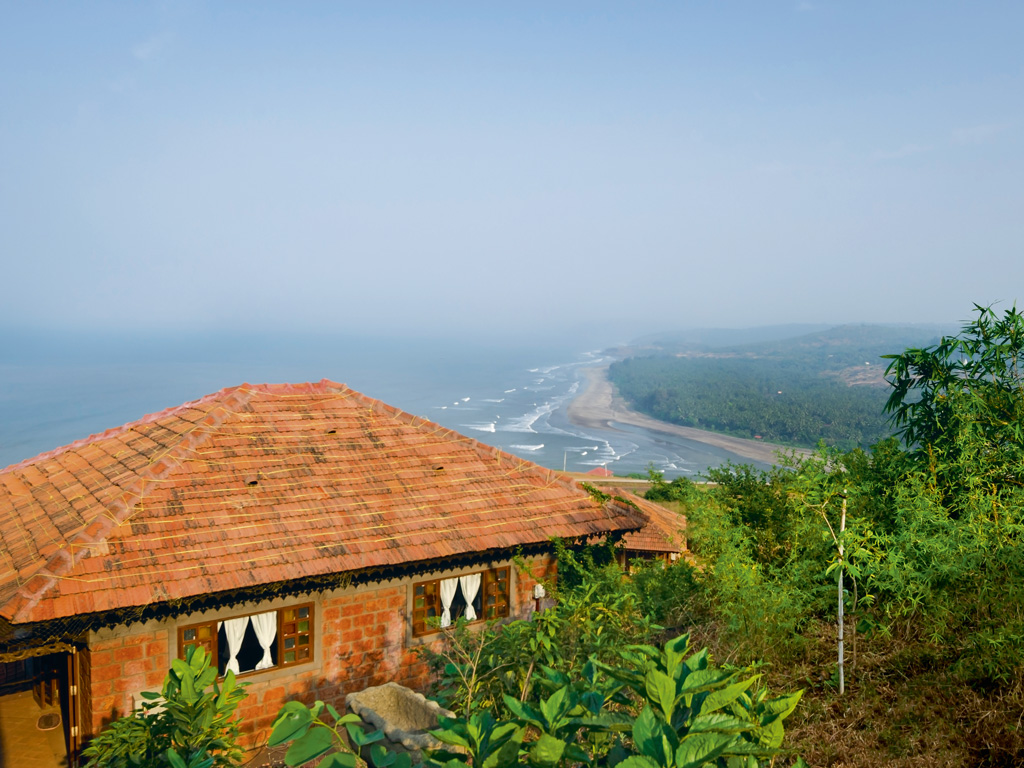 The property, which looks out over a wave-dappled coastline, is green and abundant.