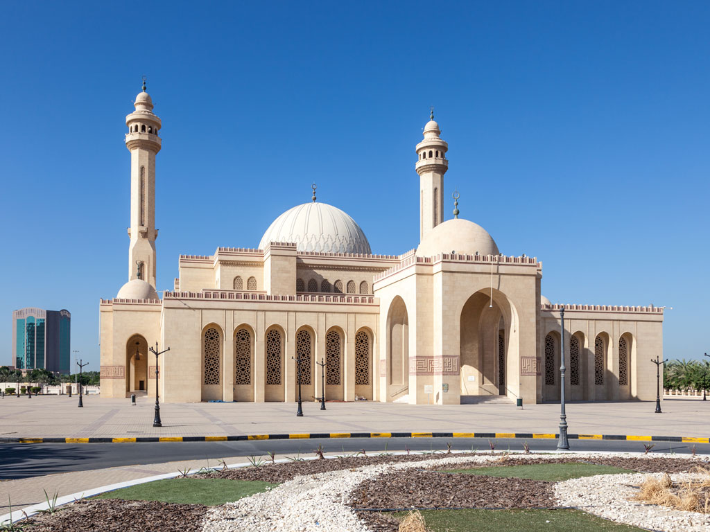 Don't go by the Ahmed Al Fateh Grand Mosque's plain exterior. Photo by typhoonski/iStock.